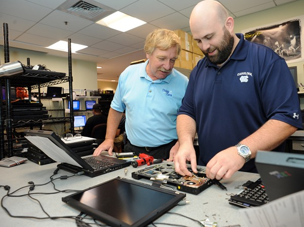 Linwood Furelle, left, chats with Kevin Lawrence, lead technician at the CCI computer repair center.