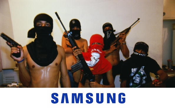 Brazil, Rio de Janerio, masked youths posing with guns, portrait
