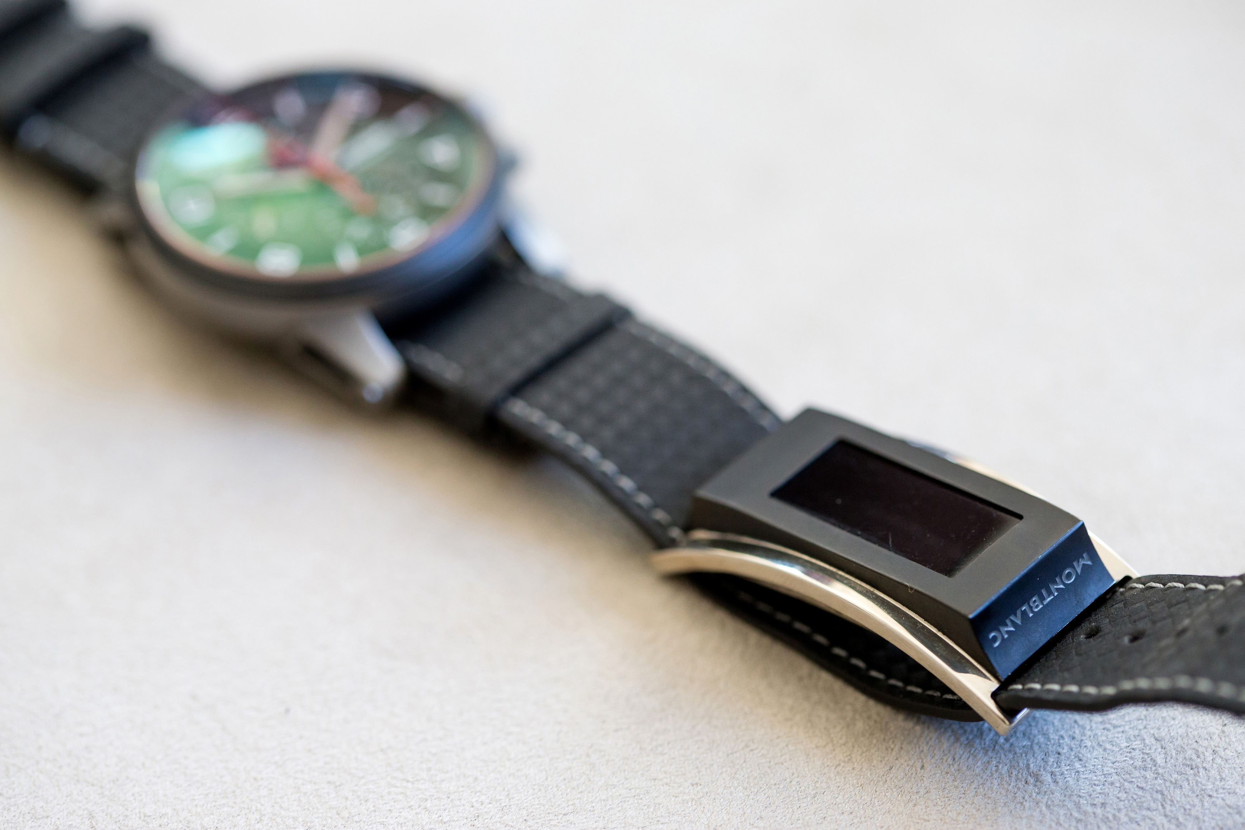 A digital wearable device, right, sits on a Montblanc TimeWalker Urban Speed e-Strap wristwatch at the Mont Blanc watch factory in Le Locle, Switzerland, on Monday, May 18, 2015. XXX ADD SECOND SENTENCE XXX Photographer: Philipp Schmidli/Bloomberg