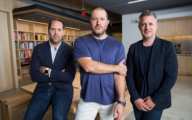 Fea0062665    Jonathan Ive- purple/blue shirt Alan Dye - taller gentleman Richard Howarth - shorter, blue t-shirt and blazer  Apple executives Tim Cook and Jonathan Ive.