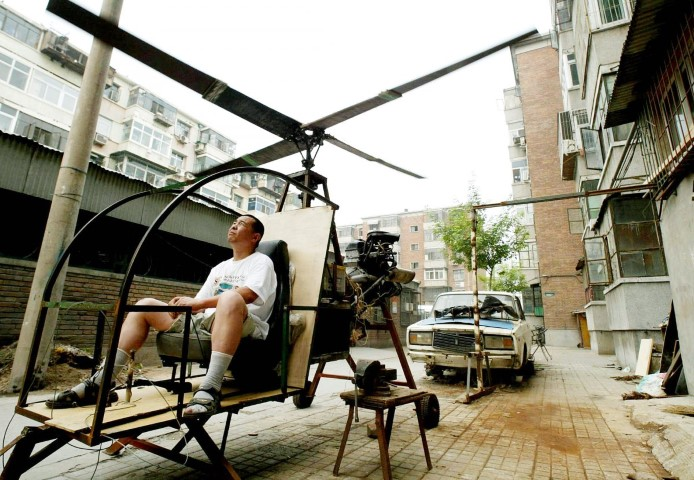 a-self-styled-chinese-inventor-named-yu-jun-tests-his-homemade-helicopter-next-to-his-apartment-in-beijing-june-25-2003