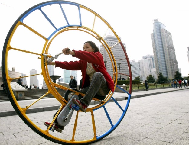 a-woman-rides-a-unicycle-at-a-park-in-shanghai-february-28-2004-the-unicycle-was-designed-by-chinese-inventor-li-yongli-who-called-it-the-number-one-vehicle-in-the-world