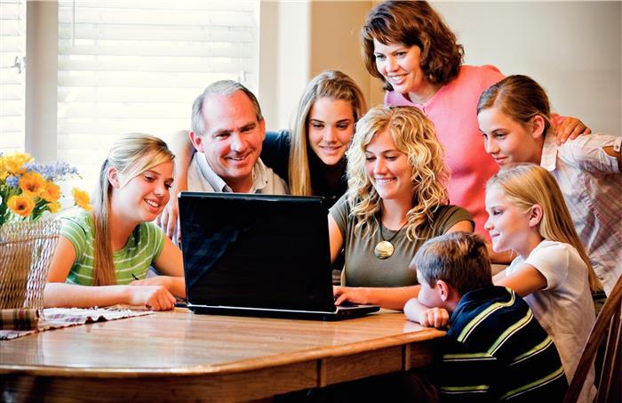 family-gathered-around-computer-415814-wallpaper-custom