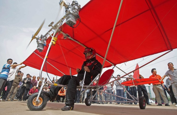 farmer-shu-mansheng-prepares-to-take-off-with-his-homemade-ultralight-aircraft-in-wuhan-hubei-province-may-10-2010
