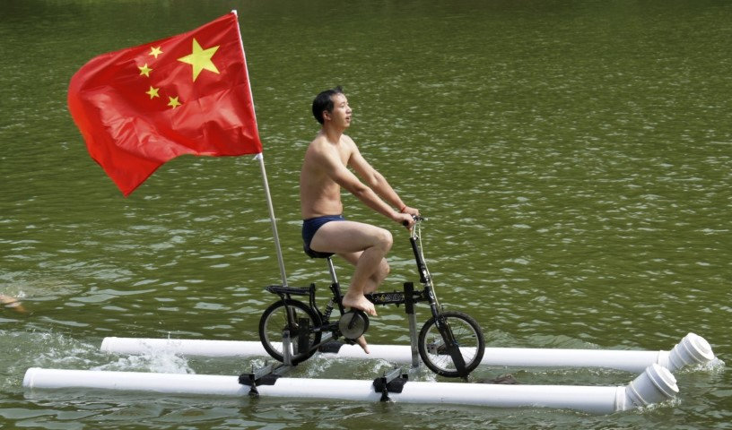 liu-wanyong-created-this-improvised-bicycle-which-is-held-afloat-by-plastic-tubes-in-zhenning-in-the-guizhou-province