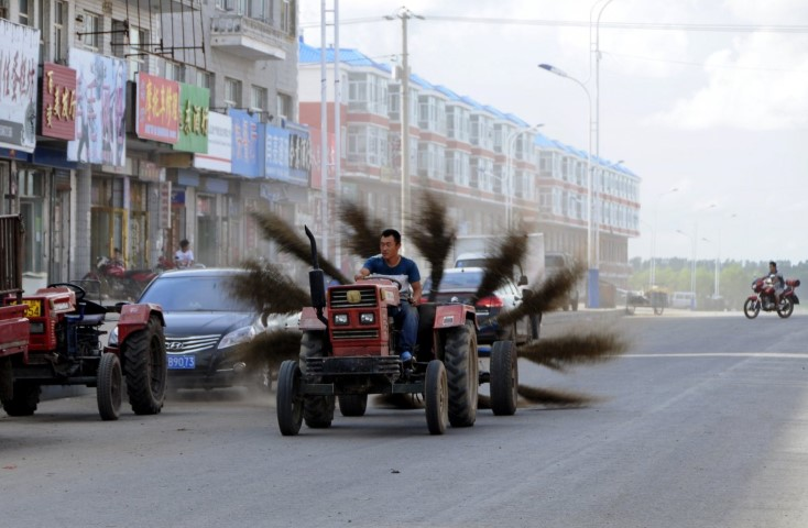 this-improvised-tractor-has-12-brooms-spinning-behind-it-and-is-used-to-sweep-the-streets-of-mohe-in-the-heilongjiang-province