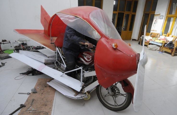 zhang-xuelin-sits-inside-his-self-made-aircraft-at-his-home-before-its-test-flight-in-jinan-shandong-province-november-28-2012