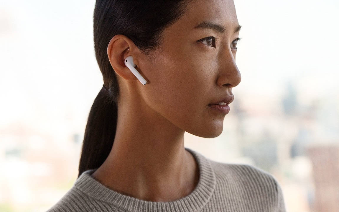 Apple AirPods on ears 600 01
